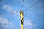 Telephone line cables radiating out fro  telegraph pole against blue sky, UK