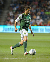 Portland forward Sal Zizzo (7) dribbles the ball.  The Portland Timbers defeated the Chicago Fire 1-0 at Toyota Park in Bridgeview, IL on July 16, 2011.