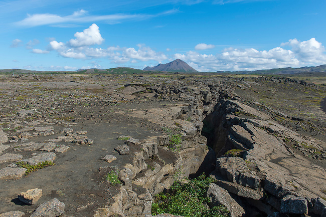 View of the top of Grjotagja, a small lava cave near Lake Myvatn with a thermal spring inside in Northeast Iceland.