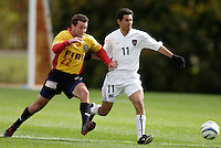 2004 Hall of Fame inductee Eric Wynalda playing for the Chicago Fire races Pablo Brenes of the MetroStars to the ball. The MetroStars defeated the Chicago Fire 2-0 during the inaugural Hall of Fame game on Monday October 11, 2004 at At-A-Glance Field at the National Soccer Hall of Fame and Museum, Oneonta, NY.