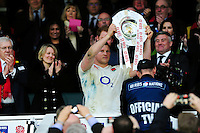 Dylan Hartley of England lifts the Triple Crown trophy after the match. RBS Six Nations match between England and Wales on March 12, 2016 at Twickenham Stadium in London, England. Photo by: Patrick Khachfe / Onside Images