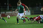 Ireland number 8 Conor Joyce kicks the loose upfield..Under 20 Six Nations.Wales v Ireland.Eirias - Colwyn Bay.01.02.13.©Steve Pope