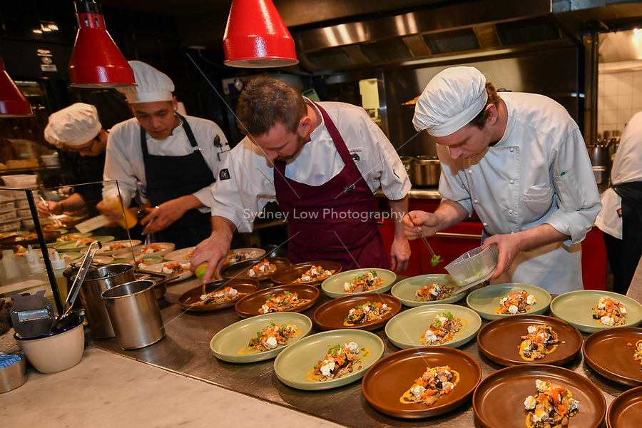 MELBOURNE, 30 June 2017 – Stuart Bell and assisting chefs prepare his dish of Red Hill goats cheese, pickled mushrooms, pumpkin, freekeh & hazelnuts at a dinner celebrating Philippe Mouchel's 25 years in Australia with six chefs who worked with him in the past at Philippe Restaurant in Melbourne, Australia.