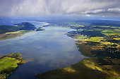 Aerial view looking over Houhora harbour & Pukenui towards Mt Camel & East beach.Far North, Northland, New Zealand.