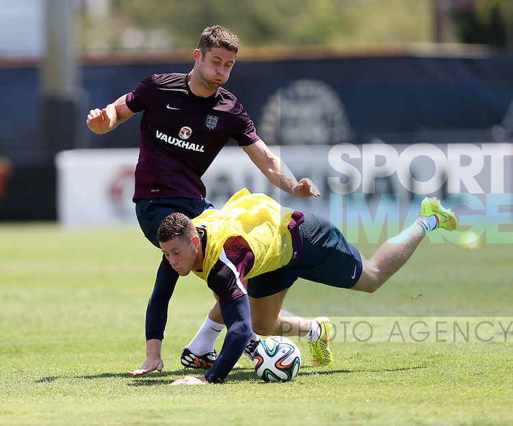England's Gary Cahill tackles Ross Barkley during training<br /> <br /> England Training &amp; Press Conference  - Barry University - Miami - USA - 06/06/2014  - Pic David Klein/Sportimage