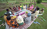 A women's savings group meets in Lukaya, Uganda, where the Good Samaritan Women's Project has helped rural women improve their financial literacy, thus improving the quality of life for the women, many of whom are widows who also care for children who lost their parents to AIDS. The program was funded by the Call to Prayer and Self-Denial of United Methodist Women.