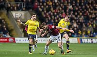 John Lundstram (right) of Oxford United knocks James Collins of Northampton Town off the ball during the Sky Bet League 2 match between Oxford United and Northampton Town at the Kassam Stadium, Oxford, England on 16 February 2016. Photo by Andy Rowland.