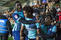 Sido Jombati of Wycombe Wanderers celebrates scoring his side's first goal with Aaron Pierre and Scott Kashket during the Sky Bet League 2 match between Newport County and Wycombe Wanderers at Rodney Parade, Newport, Wales on 22 November 2016. Photo by Mark  Hawkins.