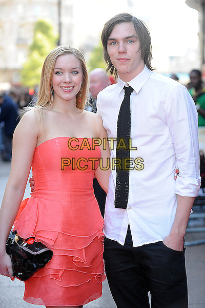 "ROSANNA HOULT & NICHOLAS HOULT.World Premiere of ""Adulthood"" held at the Empire Leicester Square, London, England, UK, .June 17th 2008 .arrivals half length red strapless dress black tie white shirt clutch bag pink .CAP/BEL.©Tom Belcher/Capital Pictures."