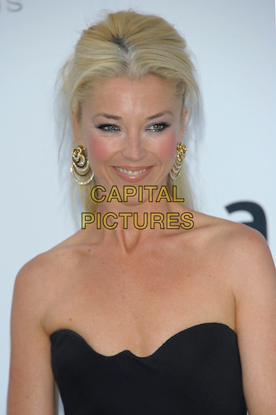 TAMARA BECKWITH.amfAR's Cinema Against AIDS Gala during the 64th Annual Cannes Film Festival at Hotel Du Cap, Antibes, France. .May 19th, 2011.headshot portrait black strapless silver gold earrings.CAP/PL.©Phil Loftus/Capital Pictures.