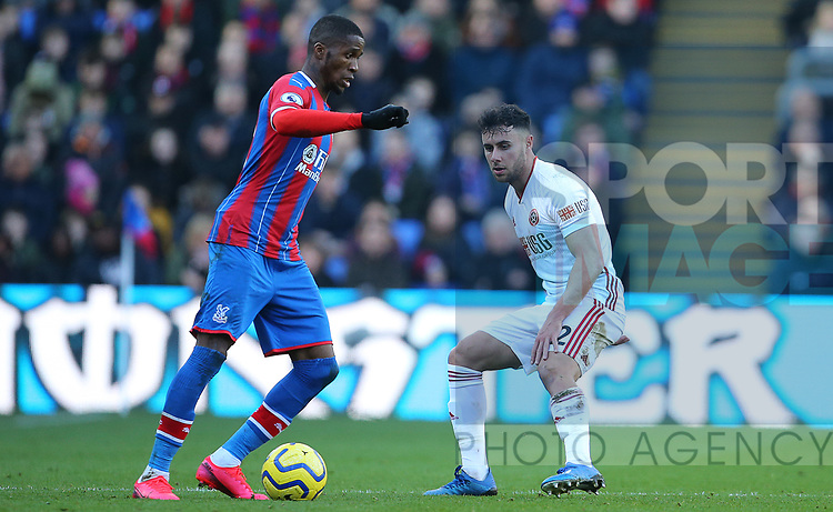 Crystal Palace's Wilfried Zaha is challenged by Sheffield United's George Baldock during the Premier League match at Selhurst Park, London. Picture date: 1st February 2020. Picture credit should read: Paul Terry/Sportimage