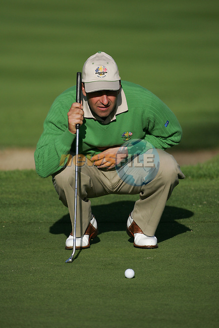 Straffin Co Kildare Ireland. K Club Ruder Cup...European Ryder cup team member Jos&eacute; Maria Olas&aacute;ballining up his putt on  the green on the forth hole during the opening fourball session of the first day of the 2006 Ryder Cup, at the K Club in Straffan, Co Kildare, in the Republic of Ireland, 22 September 2006..Photo: Fran Caffrey/ Newsfile.<br />