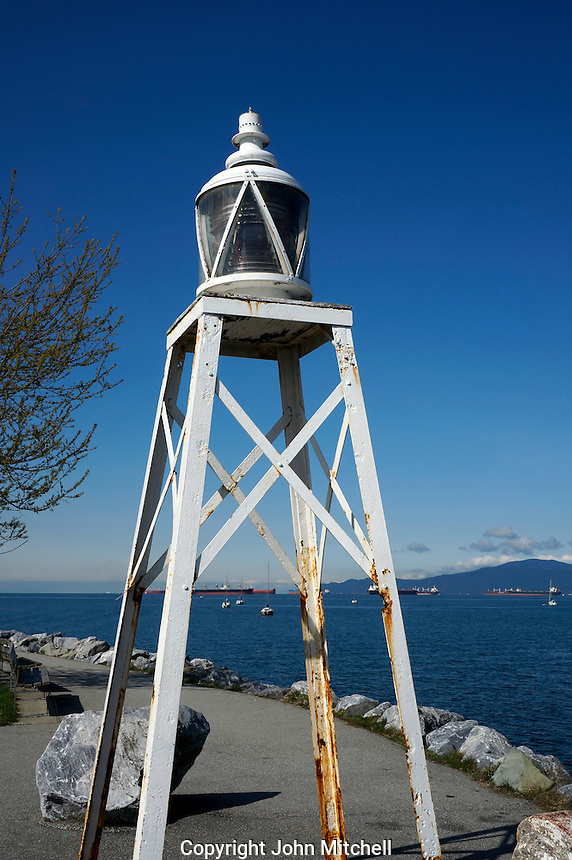 Elsje Point Lighthouse in Vanier Park with English Bay in background, Vancouver, BC, Canada