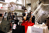Carpisa bags shop<br /> Roma May 18th 2020. Covid-19 Italy further relaxes lockdown. Today a Council of Minister's decree will allow almost all the activity to reopen. Clothes shops, shopping centers, hairdresser and churches for religious services. <br /> Photo Samantha Zucchi Insidefoto