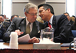 Former Nevada Gov. Robert List, left, and Gov. Brian Sandoval talk at a hearing at the Legislative Building in Carson City, Nev., on Wednesday, March 18, 2015.  <br /> Photo by Cathleen Allison