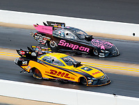 Oct 14, 2018; Concord, NC, USA; NHRA funny car driver J.R. Todd (near) races alongside Cruz Pedregon during the Carolina Nationals at zMax Dragway. Mandatory Credit: Mark J. Rebilas-USA TODAY Sports
