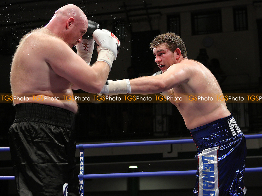 John McDermott (Horndon, blue shorts) defeats Daniel Peret (Russian Federation, black shorts) in a Heavyweight contest at York Hall, Bethnal Green, promoted by Frank Maloney (FTM Sports) - 01/02/08 - MANDATORY CREDIT: Gavin Ellis/TGSPHOTO. Self-Billing applies where appropriate. NO UNPAID USE. Tel: 0845 094 6026