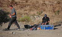 Pictured: Forensic archaeologists work at the second site in Kos, Greece. Tuesday 11 October 2016<br />