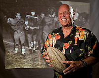Joseph Johnson '50 holds the vintage football commemorating the 1948 season. He can be seen in the photograph behind him at far left. Occidental College Raisin Bowl game 60th reunion of the 1948 football team, November 14, 2008. Homecoming weekend. (Photo by Marc Campos, College Photographer, Occidental College)
