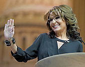 Former Governor Sarah Palin (Republican of Alaska) waves to the crowd as she speaks at the Conservative Political Action Conference (CPAC) at the Gaylord National at National Harbor, Maryland on Saturday, March 8, 2014.<br /> Credit: Ron Sachs / CNP