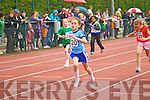 Cara O'Shea (Cahersiveen) wins the girls under 10 200m heats at the Kerry Community Games finals at Castleisland on Saturday.