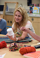 NWA Democrat-Gazette/FLIP PUTTHOFF <br /> Jenny Gammill learns about yarn Wednesday June 6 2018 before starting a weaving project.