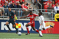 Toronto FC defender Marvell Wynne (16) is chased by Los Angeles Galaxy defender Mike Randolph (2). Toronto FC defeated the Los Angeles Galaxy 2-0 during a Major League Soccer match at BMO Field in Toronto, Ontario, Canada, on May 31, 2008.
