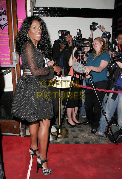 SINITTA.Grease - press night, Piccadilly Theatre, London, England..August 8th, 2007.full length black dress sheer polka dot shoes white belt .CAP/AH.©Adam Houghton/Capital Pictures