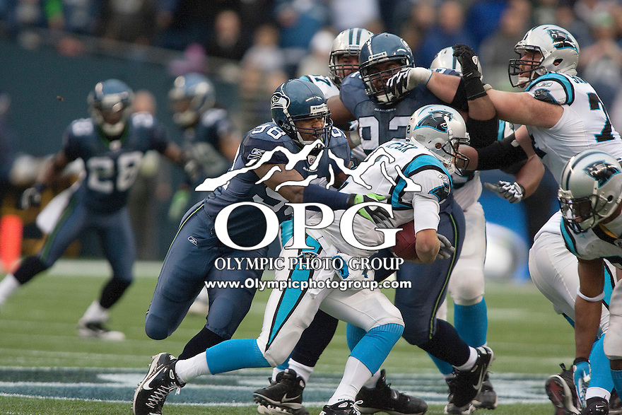 December 05, 2010:  Seattle Seahawks defensive tackle #97 Amon Gordon tackles Carolina Panthers quarterback Jimmy Clausen. Seattle won 31-14 over Carolina at Quest Field in Seattle, WA. .