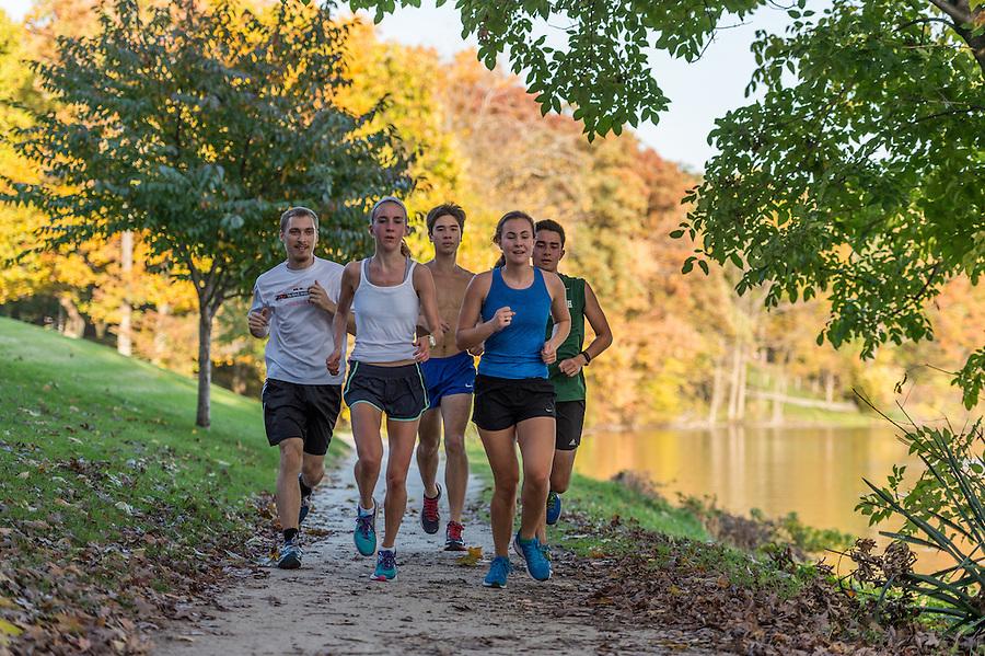 November 1, 2016; Students jog on a path around St. Joseph's Lake. (Photo by Barbara Johnston/University of Notre Dame)