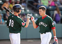 Infielder Nick Natoli (12) of the Greenville Drive, right, is congratulated by Cocy Koback (18) after hitting a rome run in a game against the Rome Braves on May 6, 2012, at Fluor Field at the West End in Greenville, South Carolina. Greenville won, 11-3. (Tom Priddy/Four Seam Images)