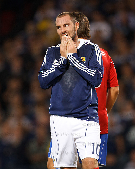 Kris Boyd grimaces after missing