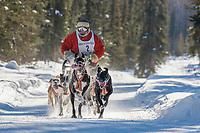 Christian Taveau drives an 8 dog team in the 2009 Limited North American sprint sled dog race, Fairbanks, Alaska.