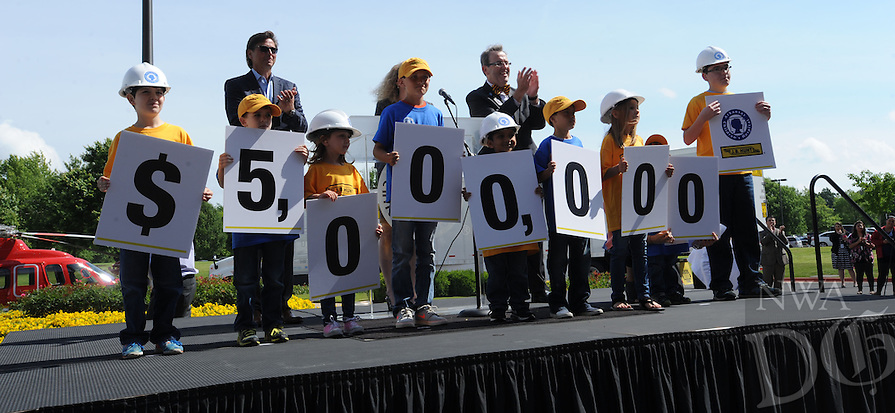 NWA Democrat-Gazette/ANDY SHUPE<br /> Children hold signsThursday, May 19, 2016, during an announcement of a $5 million gift from J.B. Hunt Transport to Arkansas Children's Hospital for the construction of its planned Northwest Arkansas campus at the J.B. Hunt corporate offices in Lowell.