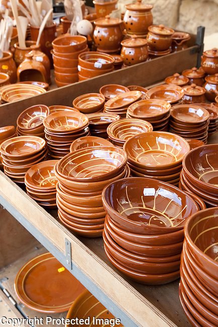 Pottery Plates and Dishes for sale on market stall in Sineu, Majorca, Spain