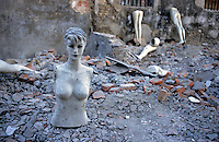 CHINA. Beijing. A mannequin lies in the ruins of an old hutong (traditional home) in the Qianmen district, destroyed to make may for new developments aimed at modernising the city for the 2008 Summer Olympics. 2005