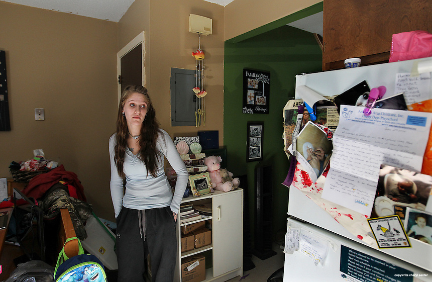 Bennington, VT -  Thursday, Jan. 30, 2014:    Recovering addict Stacey Brandmeyer, left, 22, mother of 14-month old twins, stands in the kitchen area of her public housing apartment.  <br />   <br /> Gov. Peter Shumlin devoted his entire state of the state address in January to what he called a &quot;full-blown heroin crisis&quot; in Vermont, where twice as many people died of heroin overdoses in 2012 as in the year before. Mr. Shumlin's address focused new attention on the problem, which has hit every corner of the state.  <br /> <br /> CREDIT: Cheryl Senter for The New York Times