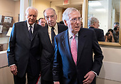 United States Senate Majority Leader Mitch McConnell (Republican of Kentucky), right, followed by US Senator Chuck Grassley (Republican of Iowa), center, and US Senator Orrin Hatch (Republican of Utah), left, arrives to make remarks at a Republican press conference in the US Capitol in Washington, DC after members of the US Senate viewed the latest FBI report on Judge Brett Kavanaugh on Thursday, October 4, 2018.  United States Senator Mike Lee (Republican of Utah) is in the background between Hatch and Grassley.<br /> Credit: Ron Sachs / CNP<br /> (RESTRICTION: NO New York or New Jersey Newspapers or newspapers within a 75 mile radius of New York City)