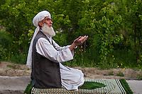 Muslim man in afternoon prayers.