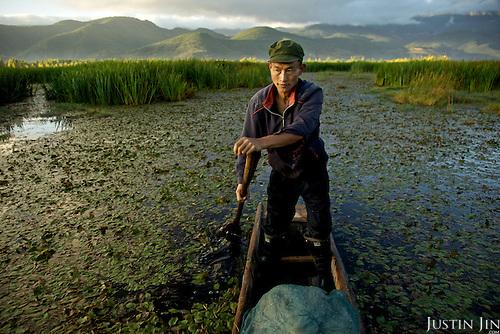 Fisherman Peng (surname) Guang Fa, 42, at the legendary Lugu Hu Lake in Sichuan Province, southwestern China.