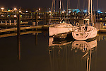 A pair of fancy yachts are at the dock in a harbor in Chicago, IL
