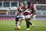 Rodrigo Palacio of Bologna battles against Nicolas Nkoulou and Diego Laxalt of Torino FC during the Serie A match at Stadio Grande Torino, Turin. Picture date: 12th January 2020. Picture credit should read: Jonathan Moscrop/Sportimage