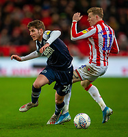 11th January 2020; Bet365 Stadium, Stoke, Staffordshire, England; English Championship Football, Stoke City versus Milwall FC; James McClean of Stoke City tackles Connor Mahoney of Millwall - Strictly Editorial Use Only. No use with unauthorized audio, video, data, fixture lists, club/league logos or 'live' services. Online in-match use limited to 120 images, no video emulation. No use in betting, games or single club/league/player publications