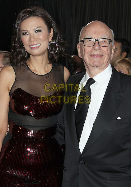 Wendi Deng Murdoch & Rupert Murdoch.85th Annual Academy Awards held at the Dolby Theatre at Hollywood & Highland Center, Hollywood, California, USA..February 24th, 2013.oscars half length married husband wife red sequins sequined dress sheer black suit white shirt tie glasses .CAP/ADM/RE.©Russ Elliot/AdMedia/Capital Pictures.