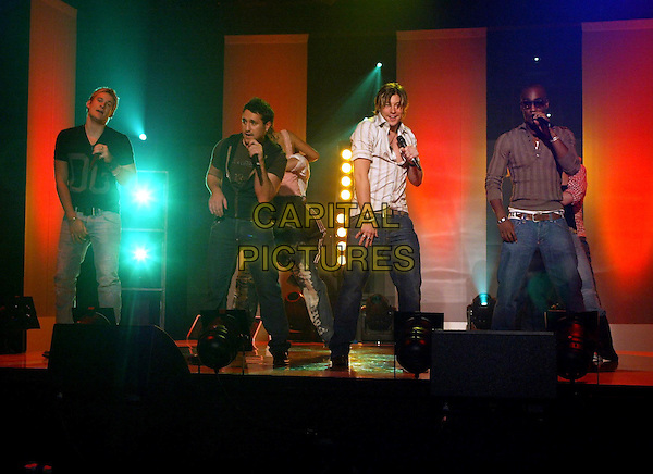 BLUE - LEE RYAN, ANTONY COSTA, DUNCAN JAMES & SIMON WEBBE .Live in concert, Milan, Italy, .28th October 2004..full length on stage gig music web sunglasses concert boy band group anthony .Ref: OME.www.capitalpictures.com.sales@capitalpictures.com.©Omega/Capital Pictures