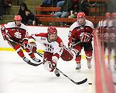 Alex Killorn (Harvard - 19), Kyle Essery (St. Lawrence - 26) - The Harvard University Crimson defeated the St. Lawrence University Saints 4-3 on senior night Saturday, February 26, 2011, at Bright Hockey Center in Cambridge, Massachusetts.