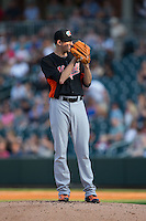 Norfolk Tides starting pitcher Kevin Gausman (39) looks to his catcher for the sign against the Charlotte Knights at BB&T BallPark on July 17, 2015 in Charlotte, North Carolina.  The Knights defeated the Tides 5-4.  (Brian Westerholt/Four Seam Images)