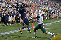 MIAMI, FL - SEPTEMBER 30:  FIU wide receiver Darrius Scott (14) attempts to pull in a reception for a touchdown in the third quarter but the pass was broken up by Charlotte University defensive back Ben DeLuca (28) as the FIU Golden Panthers defeated the Charlotte University 49ers, 30-29, on September 30, 2017, at Riccardo Silva Stadium in Miami, Florida.