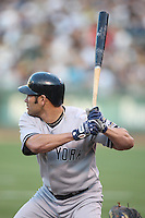 OAKLAND, CA - AUGUST 17:  Johnny Damon #18 of the New York Yankees bats against the Oakland Athletics during the game at the Oakland-Alameda County Coliseum on August 17, 2009 in Oakland, California. Photo by Brad Mangin
