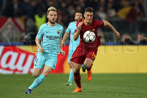 10th April 2018, Stadio Olimpico, Rome, Italy; UEFA Champions League football, quarter final, second leg; AS Roma versus FC Barcelona; (L-R) Ivan Rakitic of Barcelona beaten by the run from Patric Schick of AS Roma